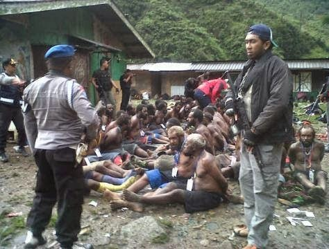 West Papuans being stripped, rounded up, and interrogated by Indonesian police in Timika