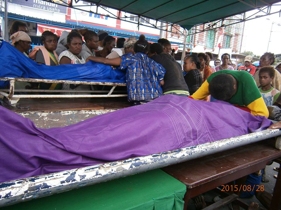 Family members grieving over the bodies of 2 West Papuans murdered by the Indonesian military today