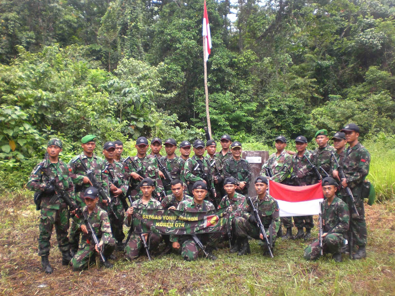Indonesian soldiers posting for a photo just meters in front of the PNG border