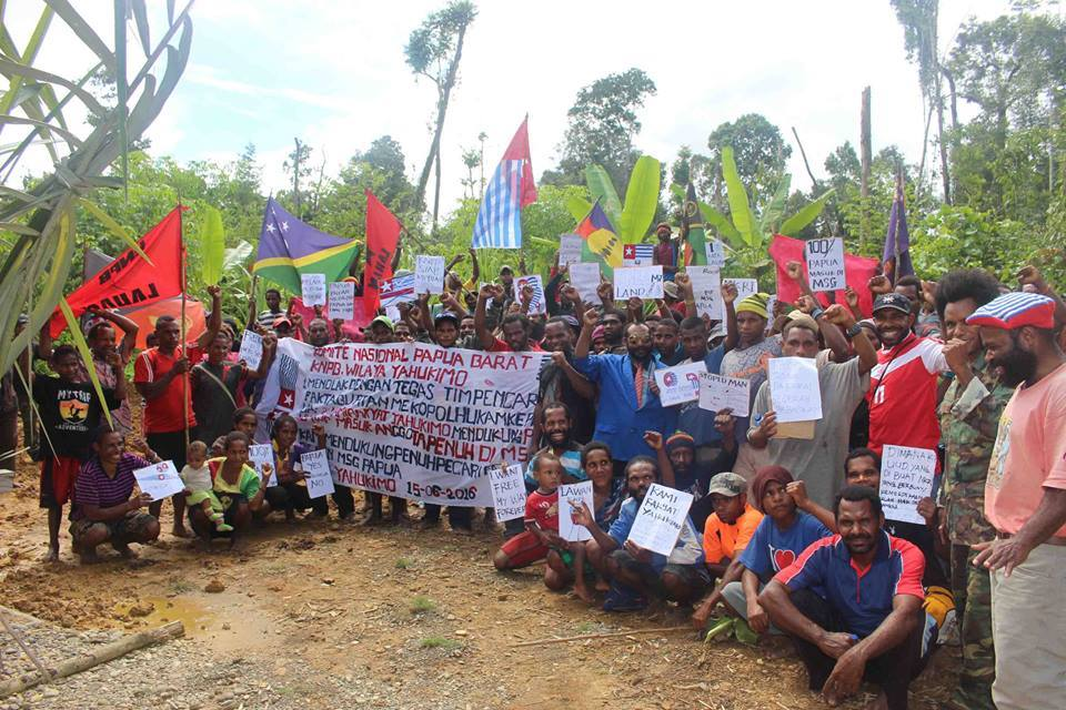 West Papuan people in Yahukimo demonstrating and holing a banner refusing the Indonesian government's claims of a Fact Finding Mission