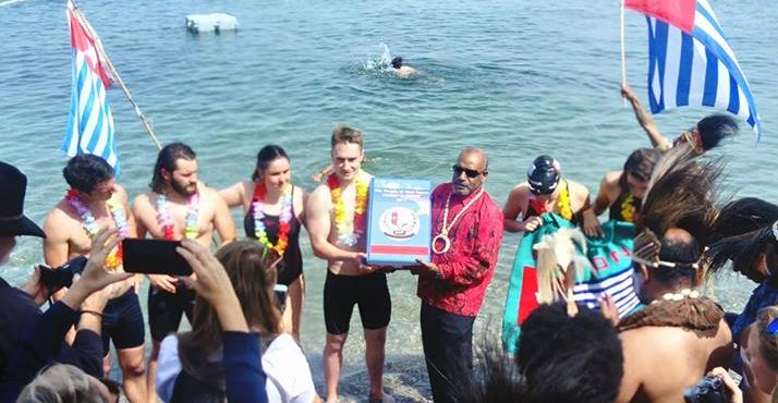 Historic swim delivers Free West Papua petition across Lake Geneva to the United Nations